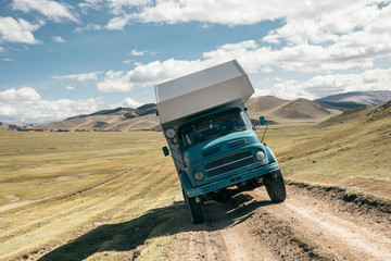 camping truck standing sideways on an offroad pist in mongolia