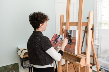 Woman painting from a dog photo