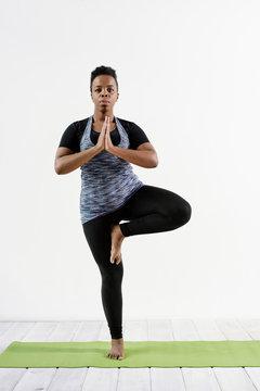 Plus-sized women doing yoga
