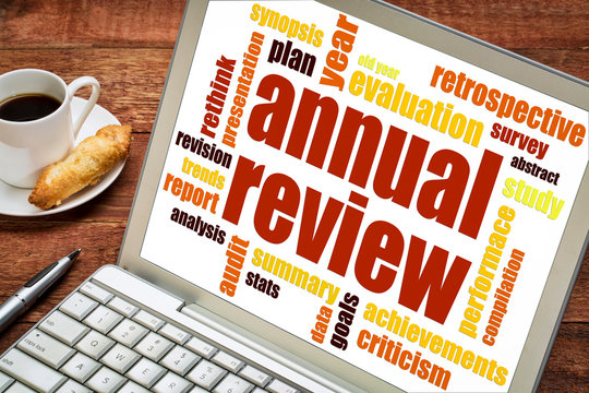 annual review word cloud on laptop