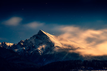 Night time landscape view of mountain peak Krivan with moonlight, High Tatras, Slovakia