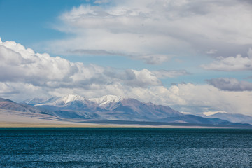 snowcovered mountains behind a big lake - tolbo nuur - in mongolia