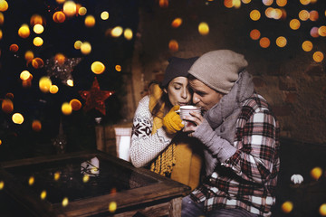 christmas love couple drinking a hot christmas punsch