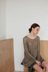Profile portrait of young stylish female indoors