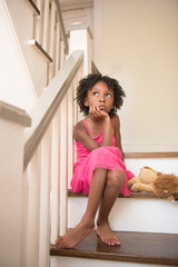 Young girl thinking on stairs