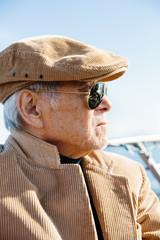 Portrait of an elderly Asian man on a boat