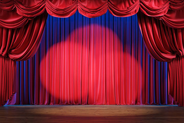 Empty theater stage with red velvet curtains and spotlights.