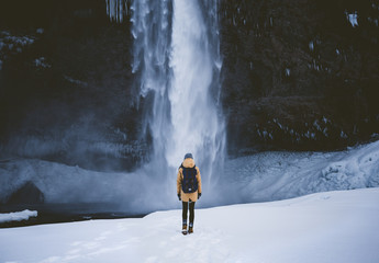 Girl near Icelandic Waterfall