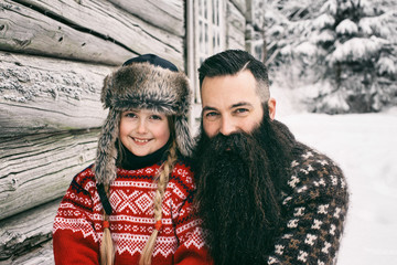 Outdoor Winter Portrait of Smiling Norwegian Dad With Cute Daugh