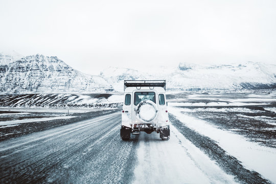 car on winter road in Iceland