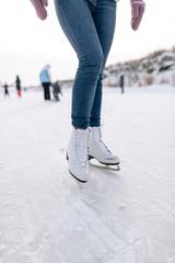 Unrecognizable woman riding skates