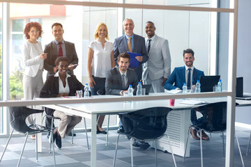 Business people posing at meeting in company