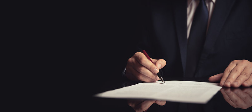 Lawyer, attorney signing a contract