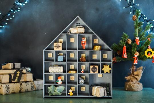 Christmas advent calendar in festive background.