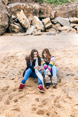 Mother and daughter on a beach in winter