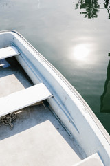 Above view of row boat surrounded by calm waters