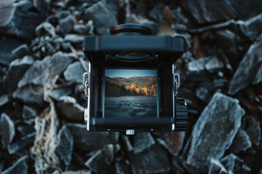Mountain landscape as seen through a vintage camera viewfinder.