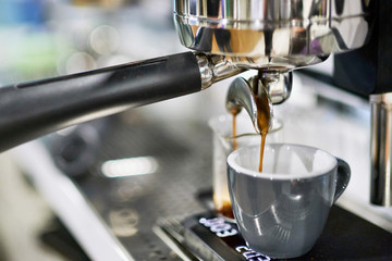 Coffee machine pouring espresso