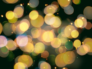 gold yellow round blurred festive lights with sparkling effect on a black background