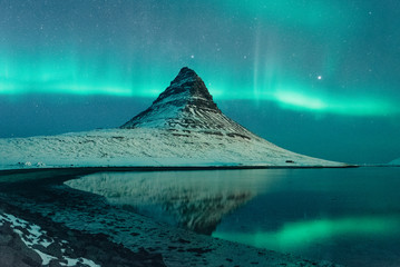 Nothern lights in winter Icelandic mountain