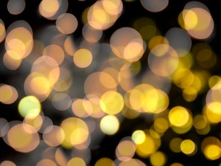 bright orange and yellow round blurred lights abstract on a black night background