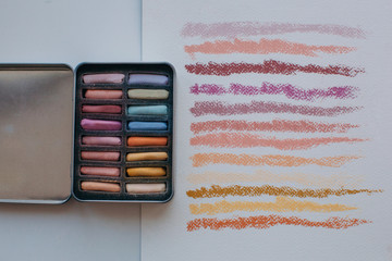 Colorful soft pastel chalks and it's swatches on paper