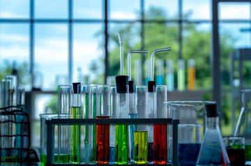 Colorful laboratory research, dropping liquid to test tubes.