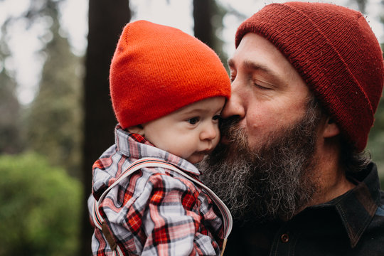 Outdoorsy Dad Snuggling Baby
