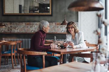 Women Sitting at Restaurant