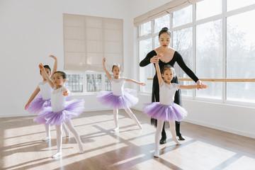 Ballet teaching teaching students in class