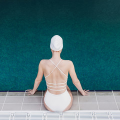 Woman Sitting by the Swimming Pool