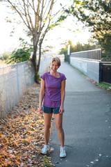 Healthy mature woman on urban morning run