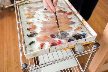 Woman painting in her studio