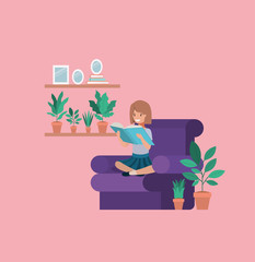 student girl sitting reading book in livingroom