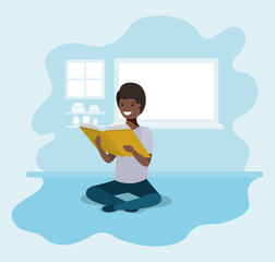 young black student sitting reading book