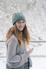 pretty brunette teen in the snow with beanie