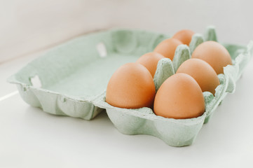 Eggs on green tray