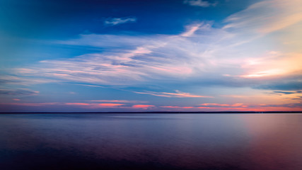 Sunset with Pink clouds over Lake Superior Horizon