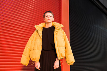 young woman  wearing yellow puffer jacket