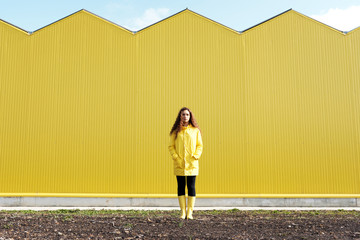 Girl against yellow building