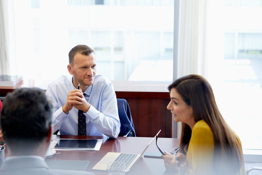 Businesswoman Explaining Male Colleagues In Office