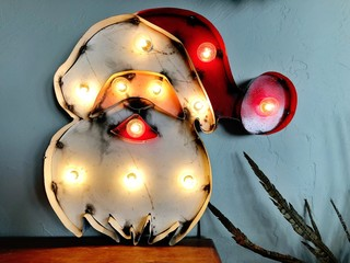 Retro Santa Claus decoration with lights for Christmas.