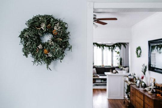 Orange and Eucalyptus Wreath on Wall
