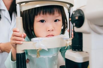 Asian little girl examine the eyes