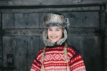 Winter Portrait of Smiling Norwegian Girl in Traditional Knitwea