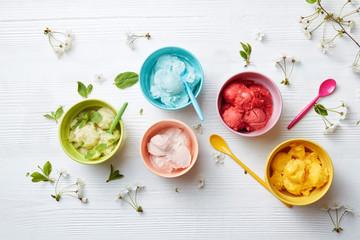 colorful ice cream in bright colored plates