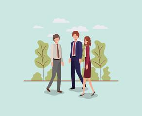 elegant businesspeople walking in the park