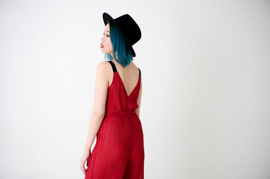 Back view of a woman with blue hair