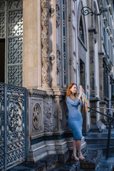 Woman taking pictures on her smartphone in Florence