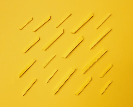 Paper craft french fries over yellow